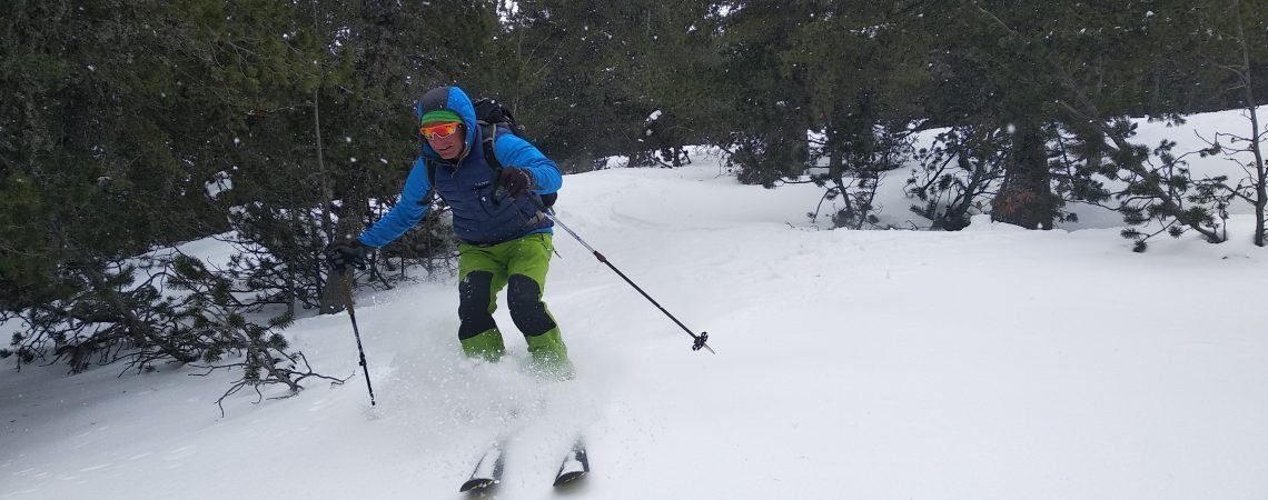 Ski riding in the forest of Pirin mountain, Backcountry skiing in Bulgaria